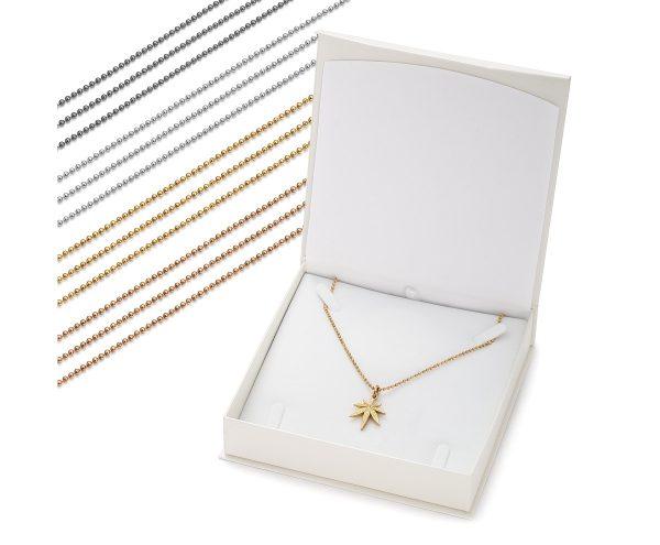 zawieszka liść z naszyjnikiem żółte złoto w białym opakowaniu